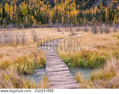 Wooden Path Leading To Lake Geyser Near The Village Of Aktash And An Autumn View Of The Altai Mounta