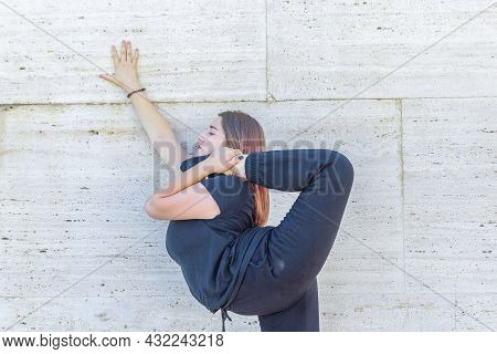 Young Girl Doing Exercise In The City, Woman Doing Yoga Exercise, Person Doing Stretching, Woman Rel
