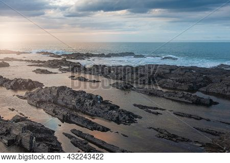 Big Boulders Of Rock And Sea Against The Sky Background
