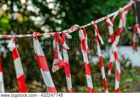 Restrictive Red And White Ribbon With Perpendicular Ribbons Tied. Stop.