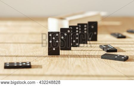 Dominos Game Pieces On Wood Table In Daylight