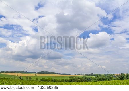 Panoramic Rural Scenery Under Wide Partly Clouded Sky At Summer Time In Southern Germany
