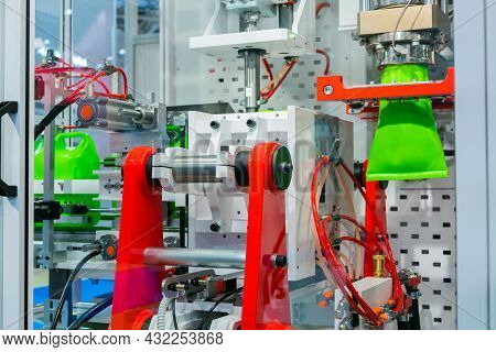 Manufacturing Of Empty Green Plastic Jerrycans At Factory, Exhibition - Automatic Blow Molding Machi