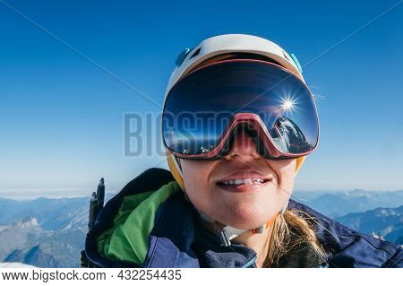 High Altitude Mountaineer Smiling Female Portrait In Safe Ski Helmet And Goggles On The Mont Blanc 4