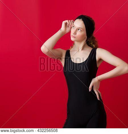 Portrait Of Slim Pretty Girl Posing At Camera. Beautiful Girl In Black Tank Top And Headband Posing