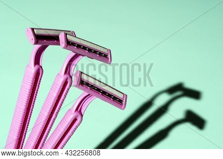 Disposable Razors, A Creative Composition Of Disposable Razors On A Turquoise Background, A Minimali