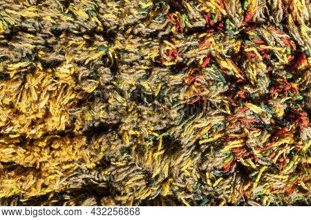 Background Of A Multi-colored Shaggy Carpet, Multi-colored Rug, Macro Photography. Abstract Texture