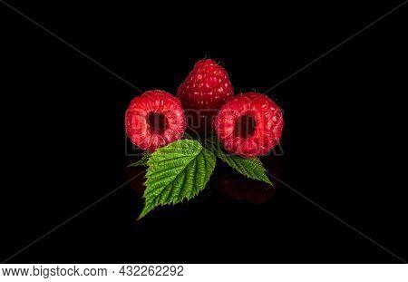 Raspberry Isolated. Raspberries With Leaf Isolate. Raspberry With Leaf Isolated On Black Background