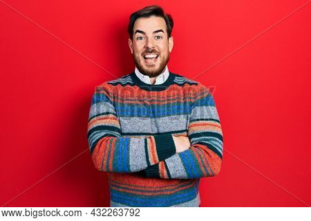 Handsome caucasian man with beard with arms crossed gesture celebrating crazy and amazed for success with open eyes screaming excited.