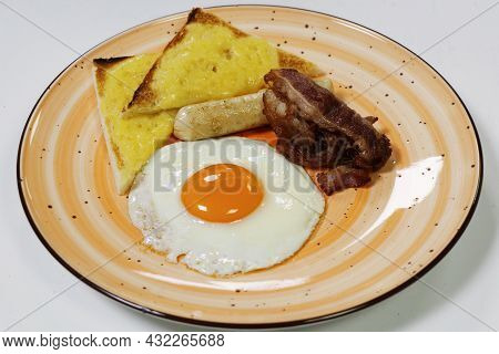 Healthy Break Fast Concept, Fried Egg Sunny Side Up, Cheese Toast, Crispy Bacon And Sausage