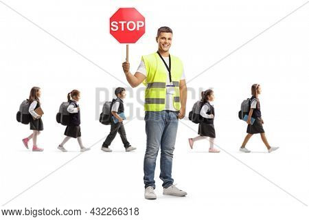 Man with a stop traffic sign and schoolchildren crossing road isolated on white background
