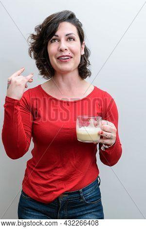 Spontaneous Photo. Brazilian Woman Holding A Cappuccino Mug And Telling A Funny Story.