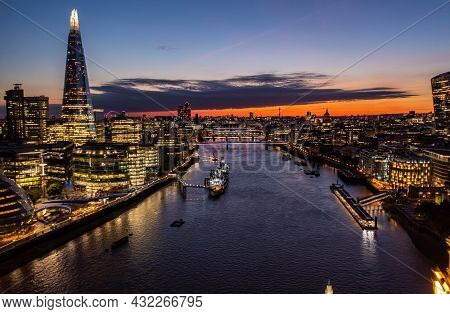 Aerial View Of Financial The Shard Tower Surrounded By Small Buildings In The Beautiful City Of Lond