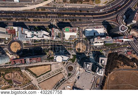 Birds Eye View Of Rooftop Of Building And Skyscrapers With Empty Street And Road In Santa Fe Which I