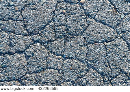 Texture Of Cracked Old Asphalt, Background Of Old Asphalt Road Or Sidewalk