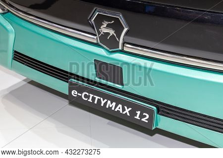 Fragment Of The Front Part Of The Gaz E-citymax 12 Electric Bus With The Manufacturers Logo And Mode