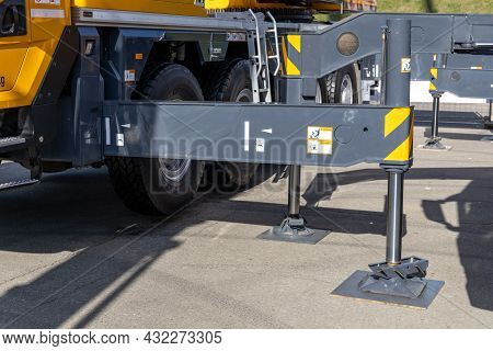 Supports Of A Powerful Mobile Cranes Xcmg. Outriggers To Ensure The Stability And Safety Of The Whee