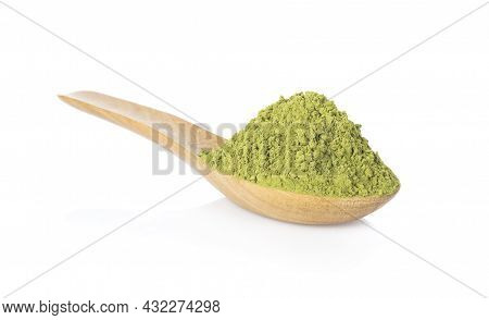 Powder Green Tea On Wooden Spoon Isolated On White Background