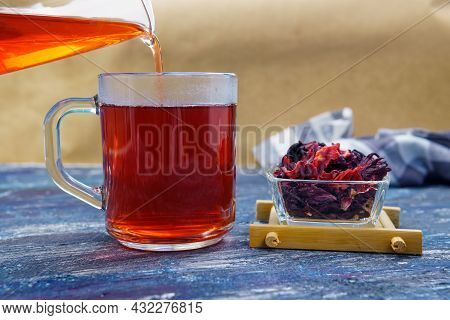 Red Hibiscus Herbal Tea Red Hibiscus Flower And Dried Herbal Tea.