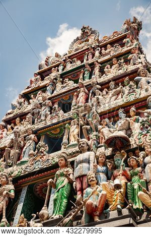 SINGAPORE, SINGAPORE - MARCH 2019: Intricate Hindu art and deity carvings on the facade of Sri Veeramakaliamman Temple in Little India, Singapore.
