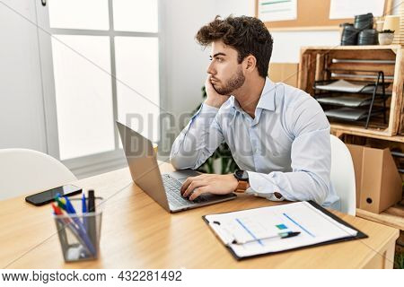 Young hispanic businessman relaxed working at the office.
