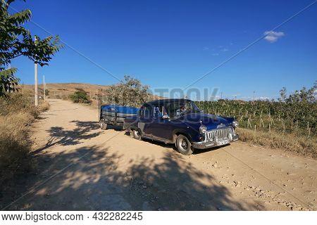 Feodosia, Russia - September 7, 2021: Famous Car Of The Soviet Era Volga - Gaz-21 Of 1957, With A De