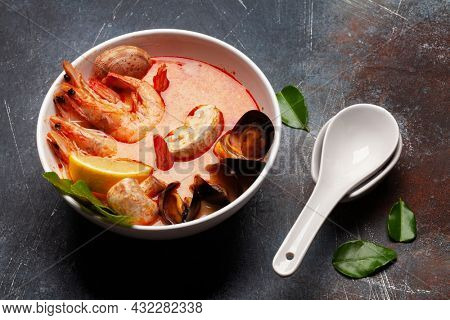 Traditional Thai soup Tom Yum kung with seafood, coconut milk and chili pepper