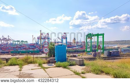 Odessa, Ukraine, South - July 21, 2021: Aerial View Of Panoramic Seaport Warehouse And Container Shi