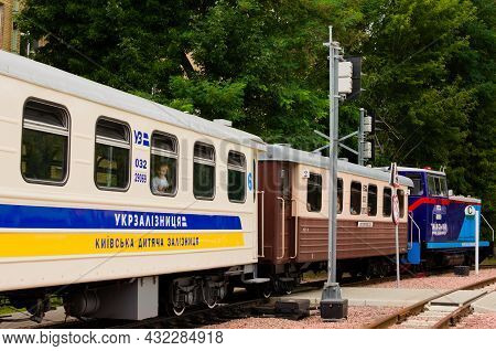 Kyiv, Ukraine-august 22, 2021:the Children's Train Passes The Station. People Look Out Of The Carria