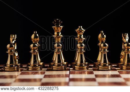 Golden Chess Figures Standing On Chessboard. Intellectual And Tactic Game. Strategy Planning, Leader