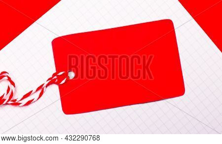 On A Red Background, A White Sheet Of Paper And A Clean Red Price Tag With A Place To Insert The Dou