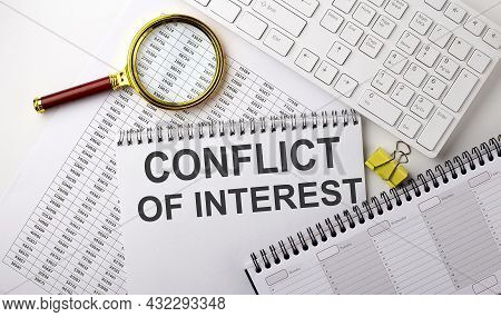 Conflict Of Interest Text Written On Notebook On Chart With Keyboard And Planning