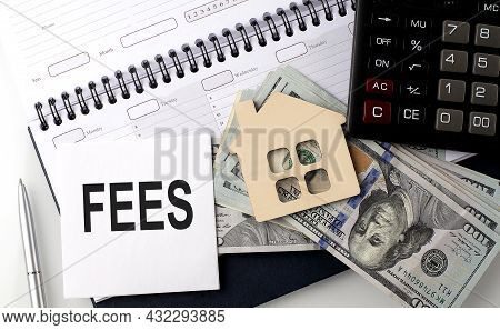 Fees - The Inscription Of Text On The Sticker On The Planning With Dollars And Calculator