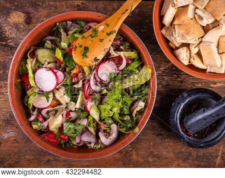 Cooking Syrian Vegetable Salad With Pita And Sumac Dressing - Fattush. Dressed Vegetarian Salad In B