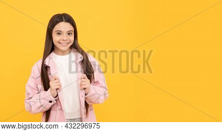 Happy Teen Girl In Checkered Shirt. Smiling Hipster Kid Casual Style. Tween Child Wear Plaid Shirt.