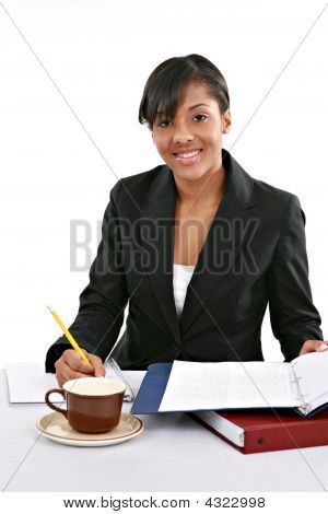 Cheerful Young African American Female Working In The Office