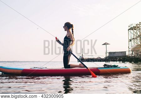 Close-up Of A Girl Doing Yoga On Sub Board. Psychology Meditation, Relaxation And Self-healing Conce