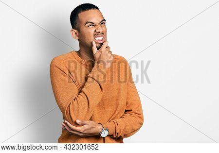 Young african american man wearing casual clothes thinking worried about a question, concerned and nervous with hand on chin