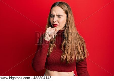 Young blonde woman wearing turtleneck sweater feeling unwell and coughing as symptom for cold or bronchitis. health care concept.