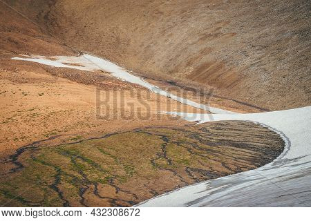 Sunny Mountain Desert Relief With Long Glacier On Slope In Sunlight. Scenic Highlands Landscape With