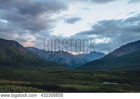Beautiful Scenery With Mountains Silhouettes Under Sunset Cloudy Sky. Atmospheric Mountain Landscape