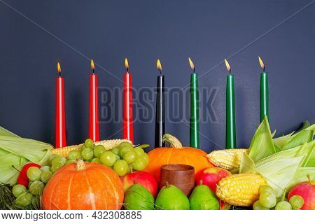 Kwanzaa Afro-american Holiday With Candles On Dark Background. Seven Candles As Symbol Of Principles
