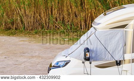 Camper Car With External Thermal Screen Blind At Front Windscreen. Camping On Nature. Holidays And T