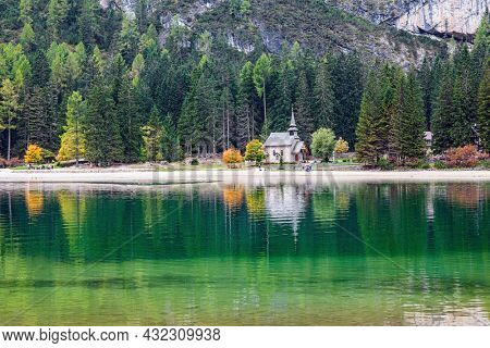 The Lago di Braies.The most beautiful mountain lake in Northern Italy. The surrounding mountains are reflected in the blue-green clear water of the lake. South Tyrol, Dolomites.