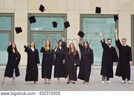 Students In Robes Throw Up Academic Caps And Are Happy To Receive Higher Education.