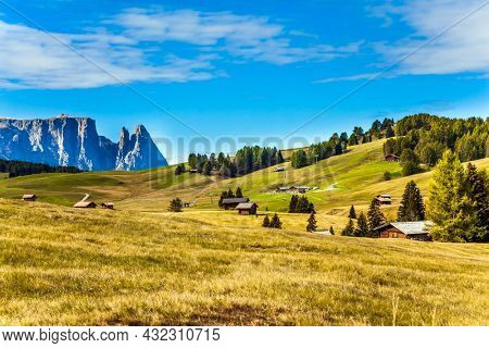 Val Gardena, Italy. Alpe di Siusi is charming plateau in the Dolomites. Powerful ridge of rocks on the horizon. Beautiful sunny day for hiking and taking photos.