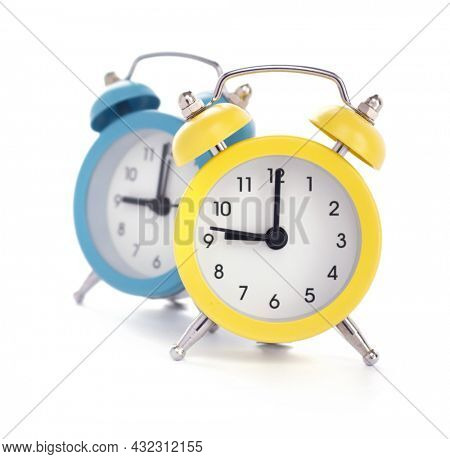 Alarm clock isolated on white  background. Office alarm clock front view