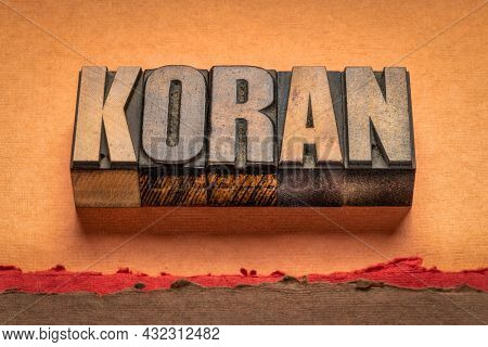 koran - word abstract in vintage letterpress wood type, the Islamic sacred book, believed to be the word of God