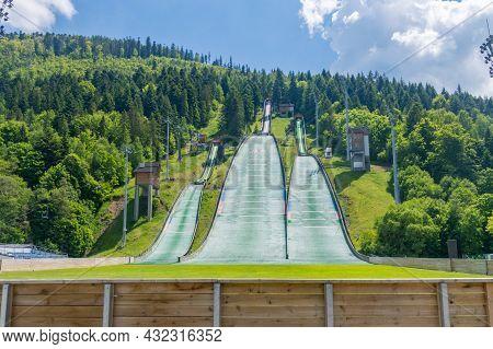 Szczyrk, Poland - June 6, 2021: Skalite Ski Jump Complex Named After The Beskid Olympians At Summer