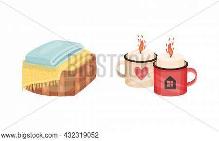 Warm Folded Blanket Or Plaid And Mug With Burning Candles As Hygge And Coziness And Comfortable Symb